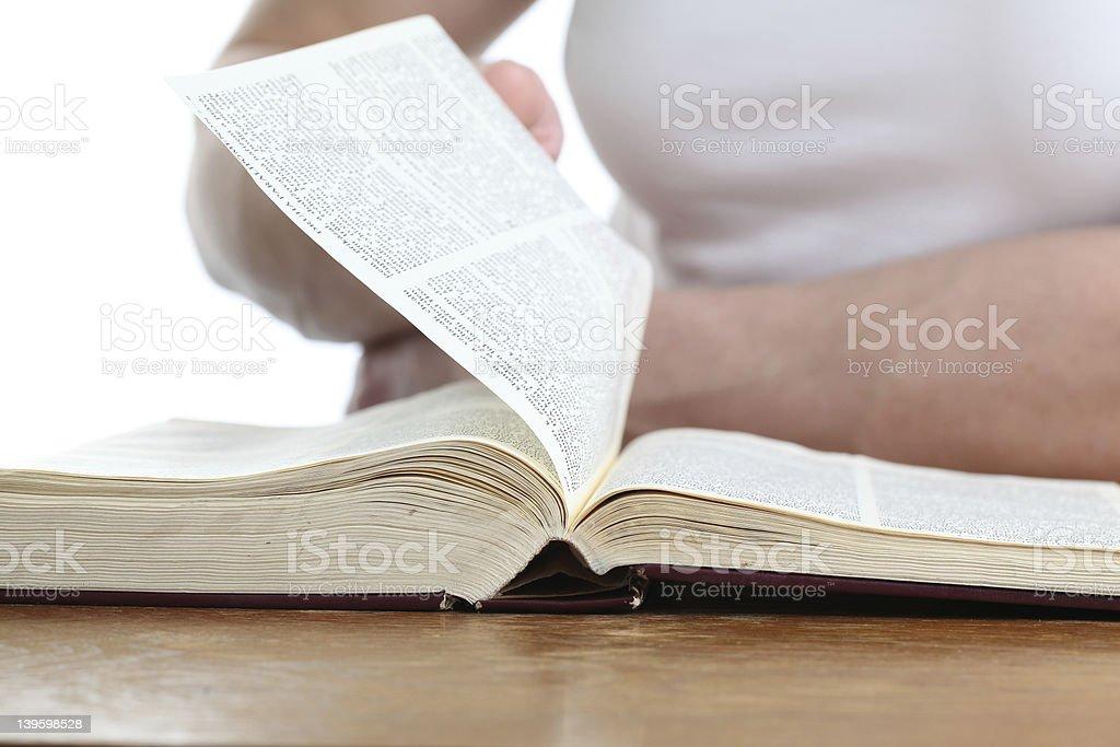 Man turning page of Bible royalty-free stock photo