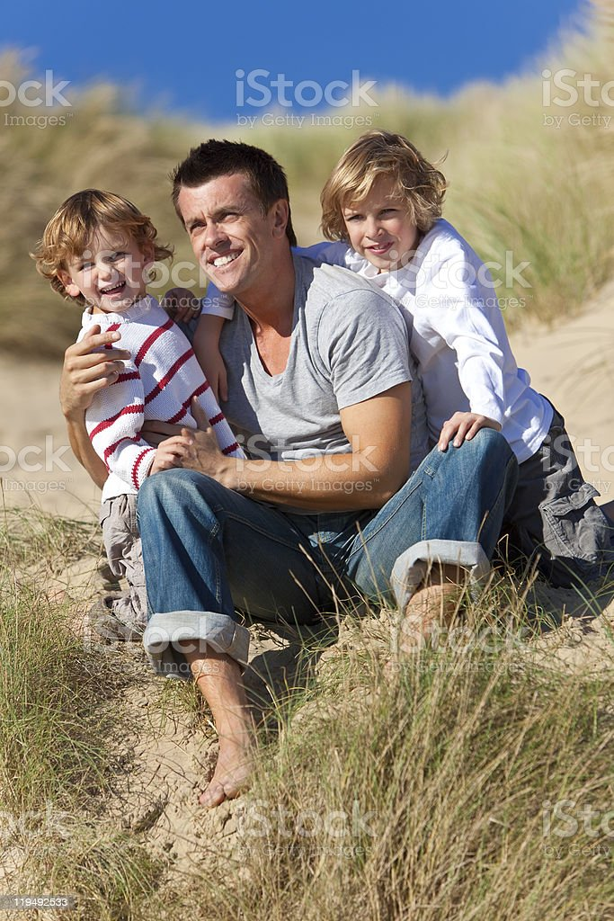 Man & Two Boy, Father and Sons Having Fun At Beach royalty-free stock photo