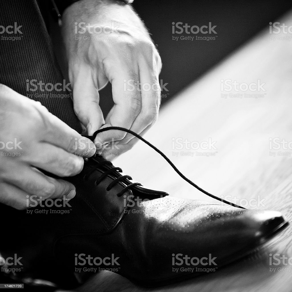 Man tying his shoelace royalty-free stock photo