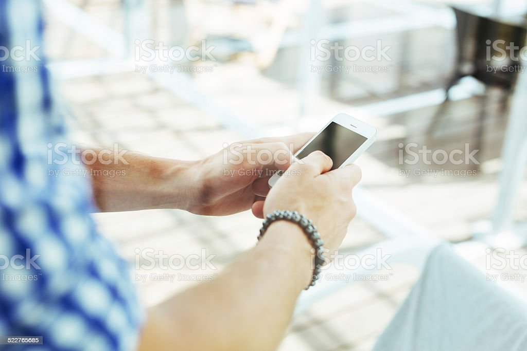 Man typing a message on a smartphone stock photo