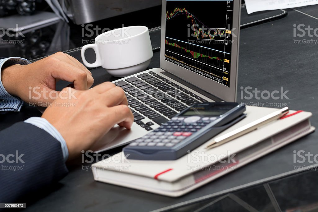 man typing on computer keyboard on screen in the office stock photo