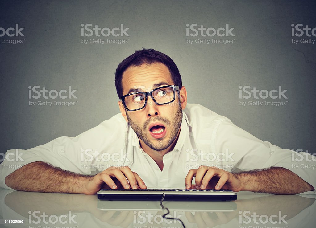 Man typing on keyboard wondering what to reply stock photo