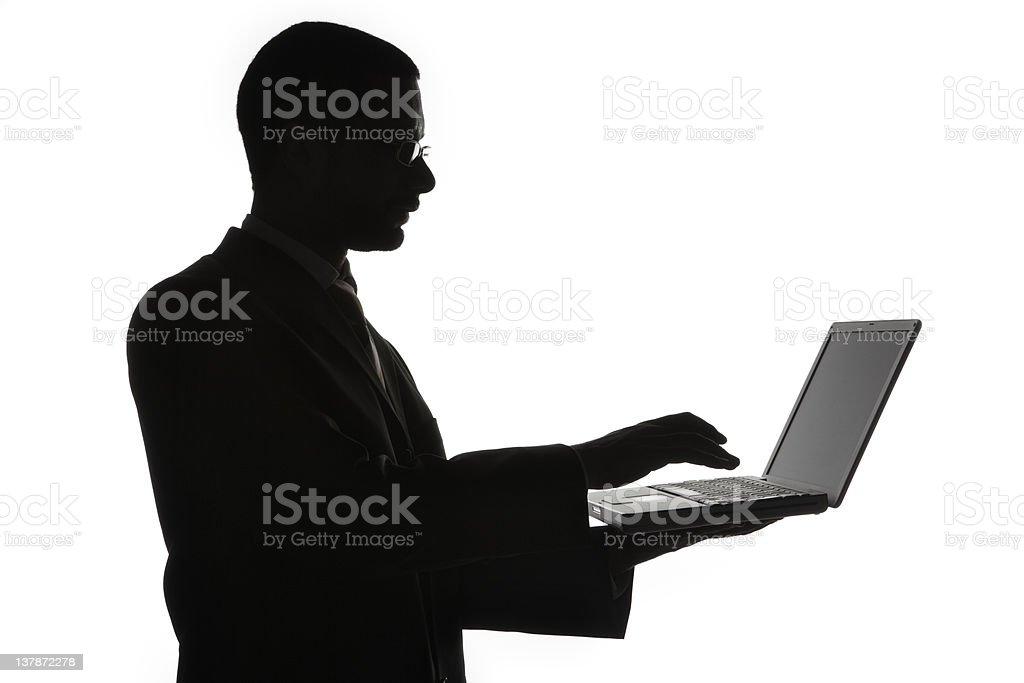 Man typing on laptop computer royalty-free stock photo