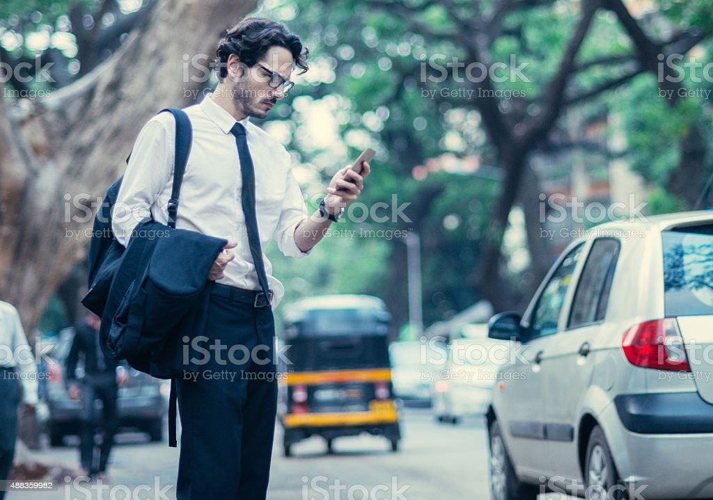 man typing text message after work stock photo