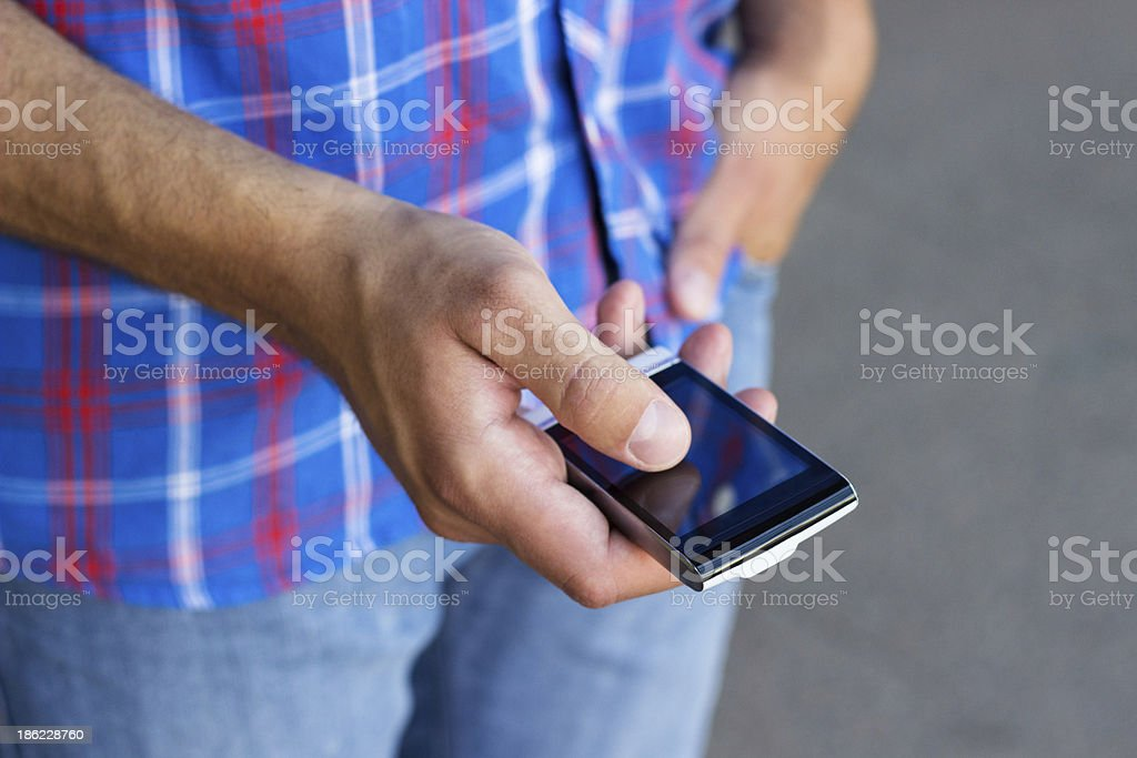 Man typing text message royalty-free stock photo