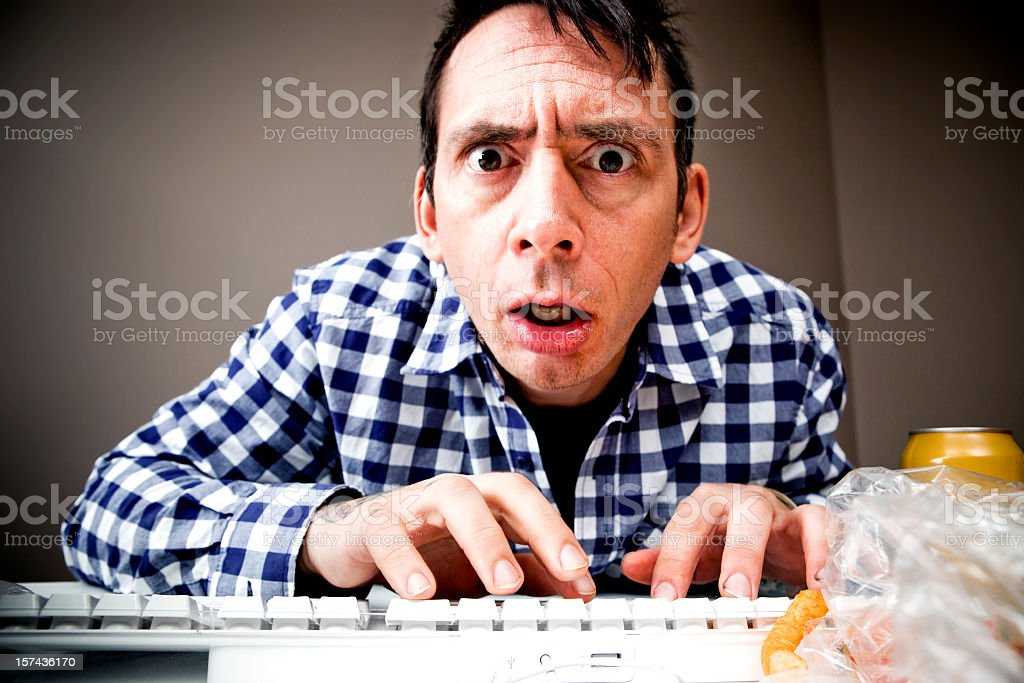 Man typing while trying to meet a deadline royalty-free stock photo