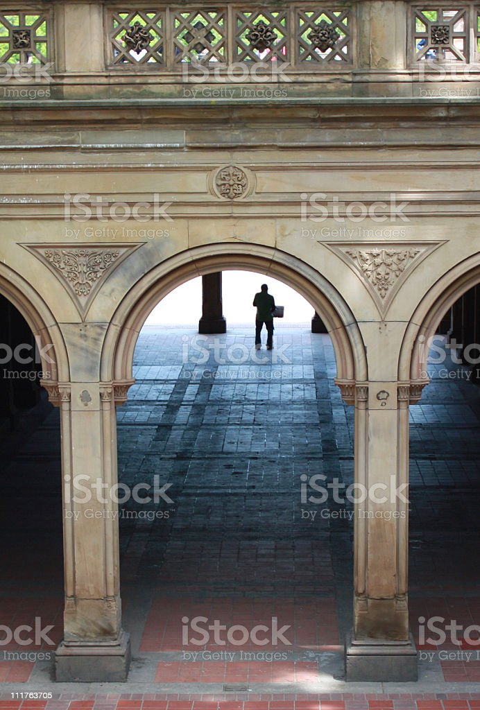 Man Under Central Park Archway stock photo