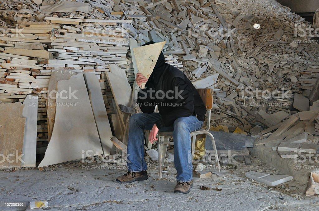 man under pile of broken marble royalty-free stock photo