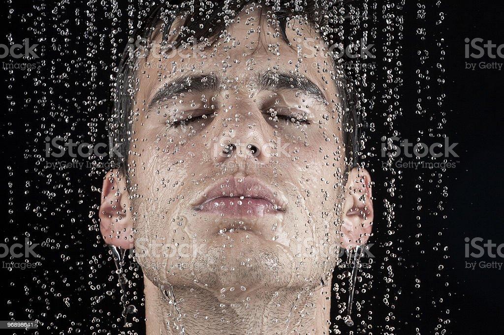 man under the shower stock photo