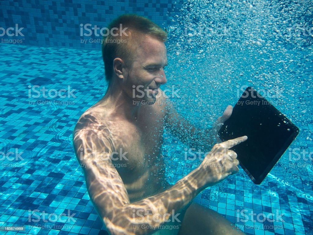 Man Underwater Using Touchscreen Tablet Computer with Blank Screen royalty-free stock photo