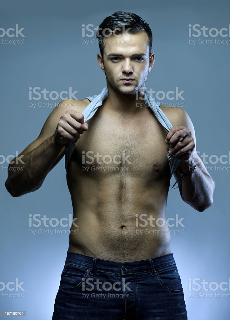 man undressing royalty-free stock photo