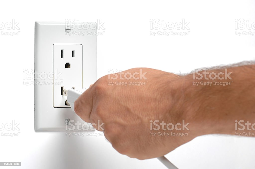 Man unplugging electrical cords on white stock photo