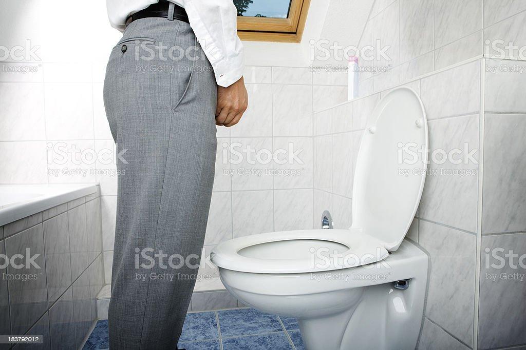 man urinating standing up stock photo