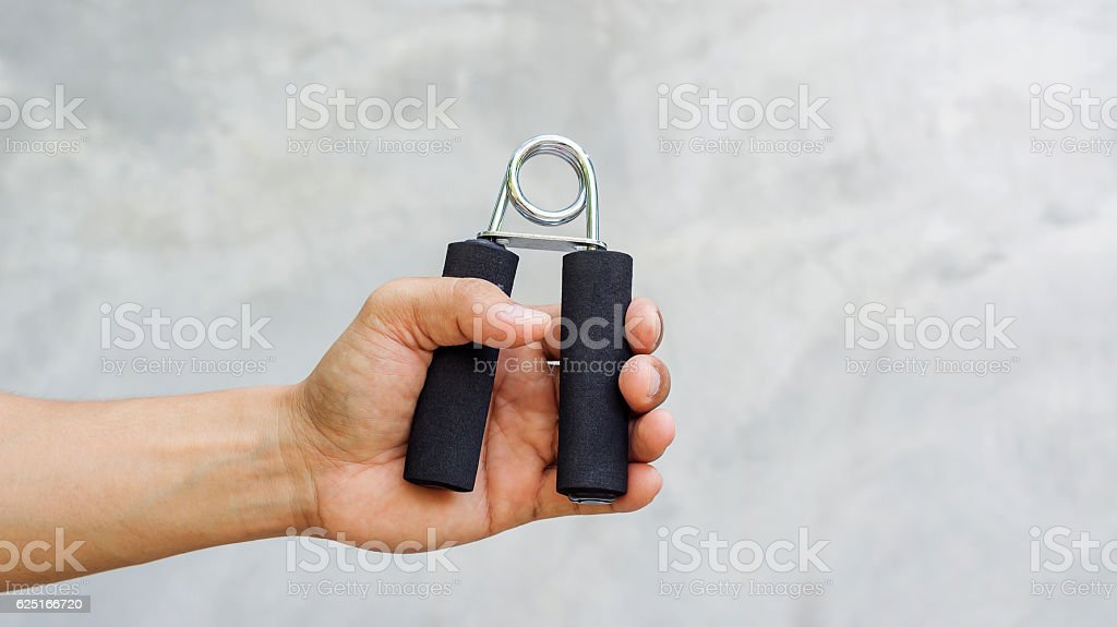 Man use handgrips for exercise. stock photo