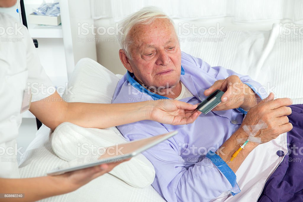 Man uses a credit card payment over the internet stock photo