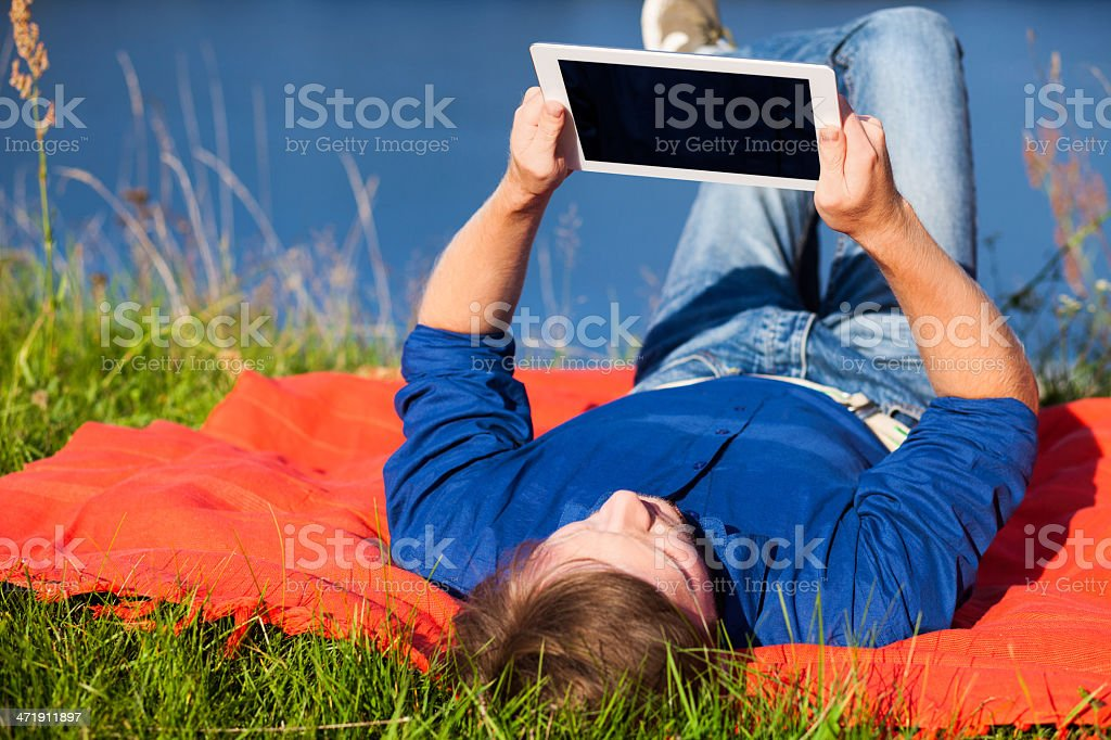 Man uses digital tablet royalty-free stock photo