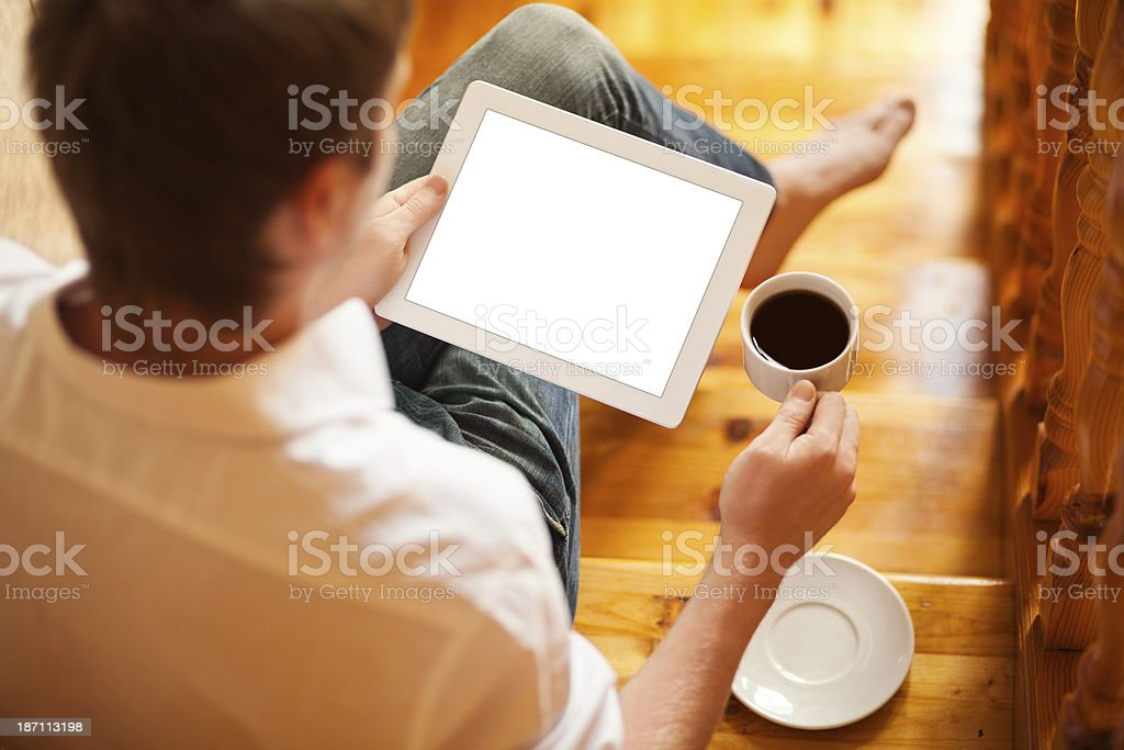 Man uses digital tablet with blank screen royalty-free stock photo