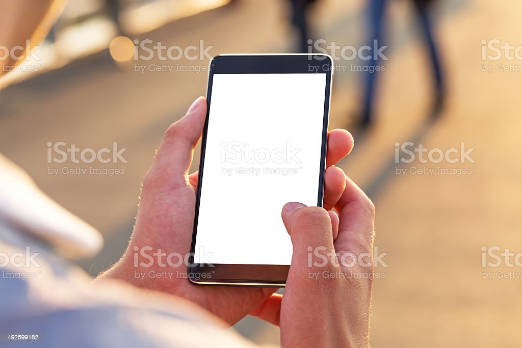 Man uses his Mobile Phone outdoor stock photo