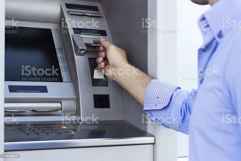 Man using a ATM stock photo