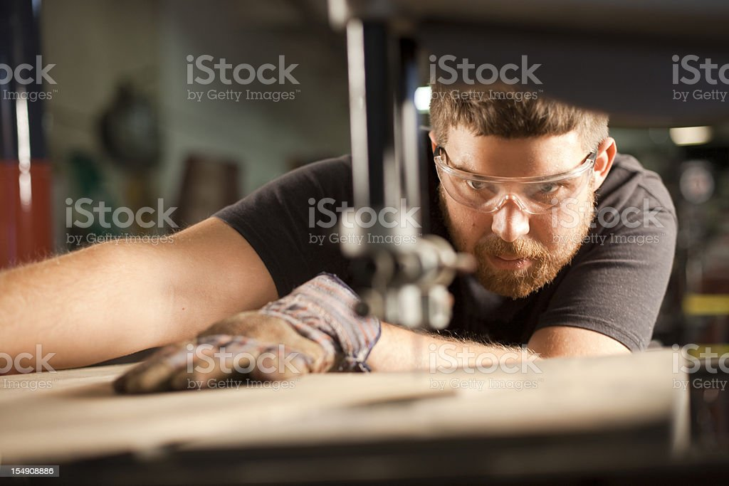 Man Using a Bandsaw stock photo
