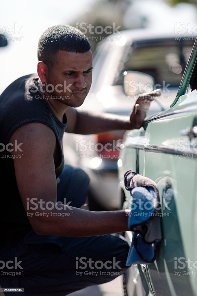 Man Using A Cloth To Polish His Vintage Car stock photo