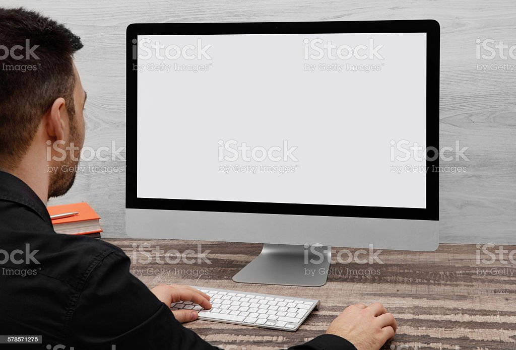 Man using a computer stock photo
