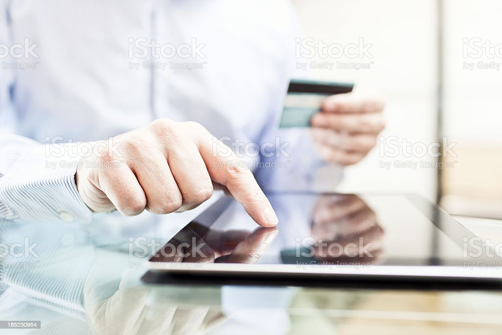 Man using a digital tablet for online buying royalty-free stock photo