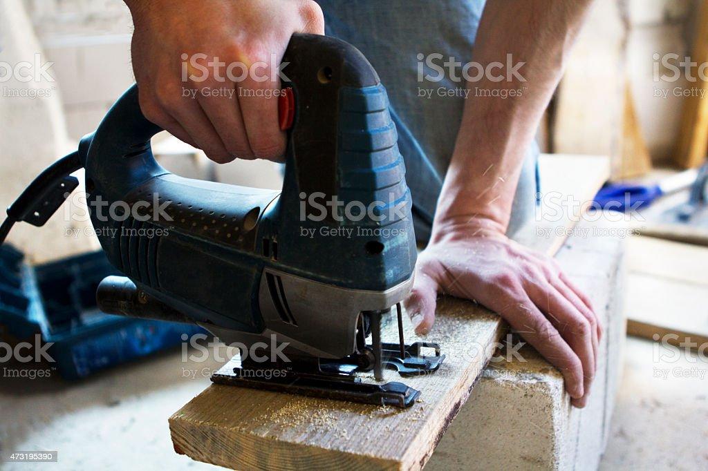 man using a jigsaw. stock photo