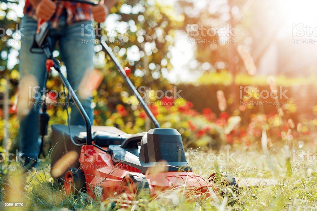 Man using a lawn mower stock photo