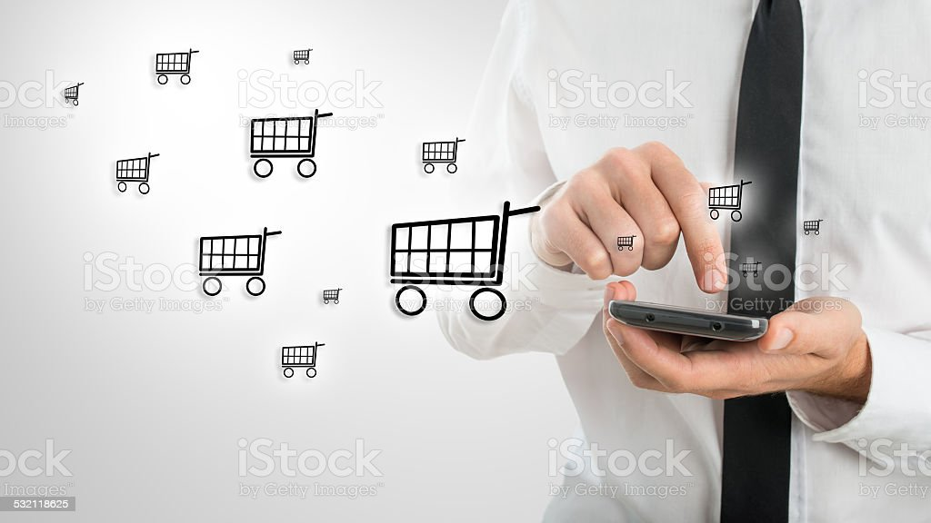 Man using a mobile to shop online stock photo