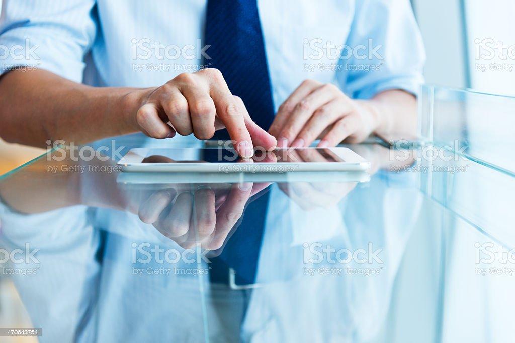 A man using a modern digital tablet stock photo