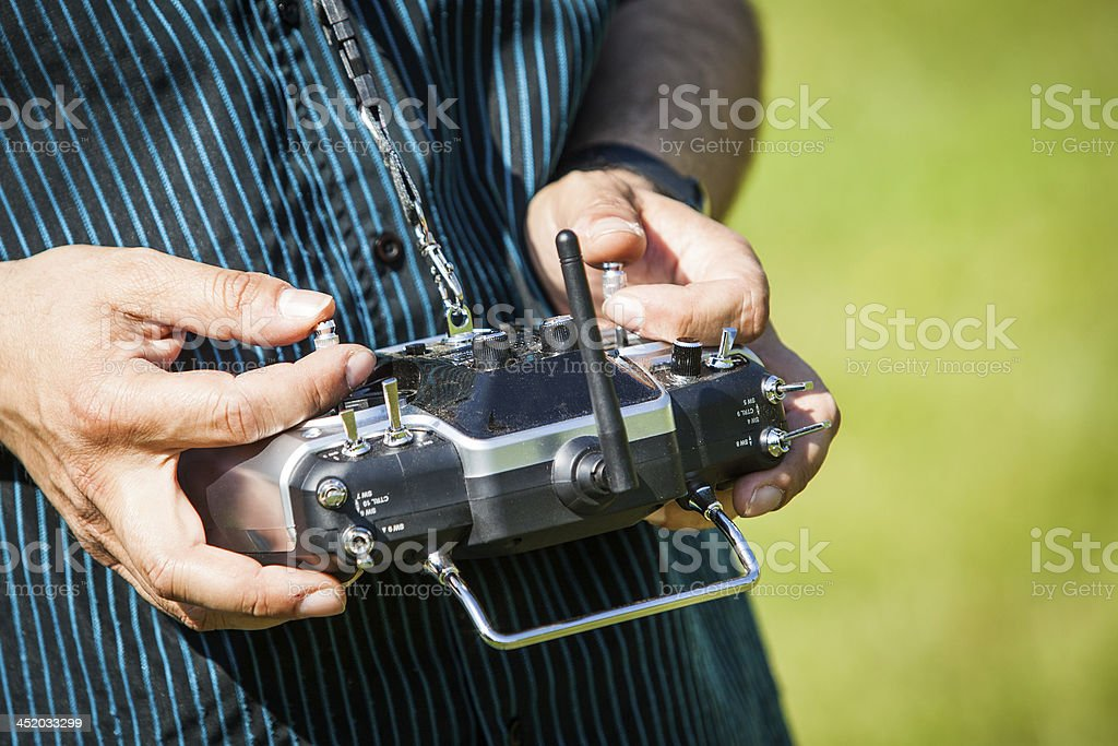 Man using a remote control outside stock photo