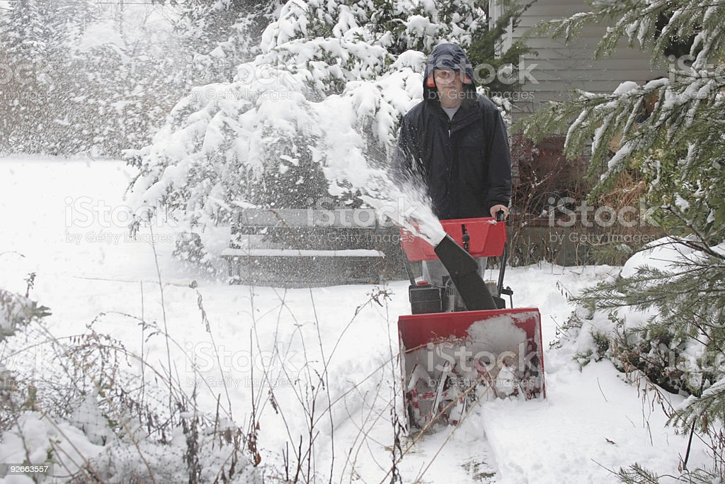 Man Using A Snow Blower royalty-free stock photo