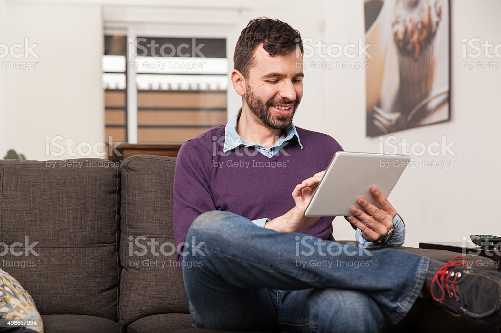 Man using a tablet at home stock photo