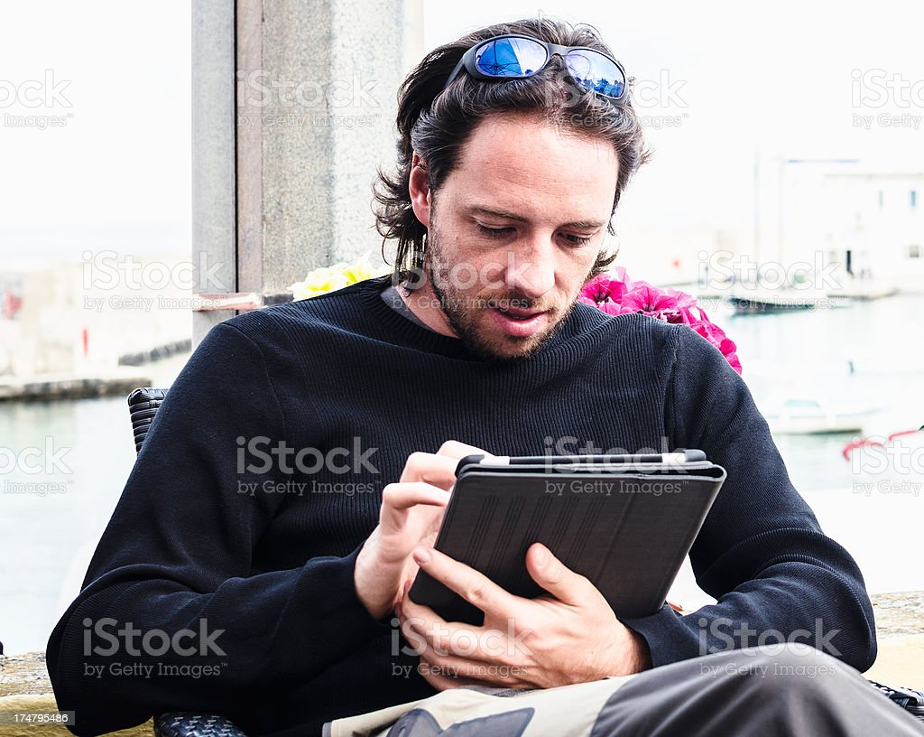 Man using a tablet outdoors royalty-free stock photo