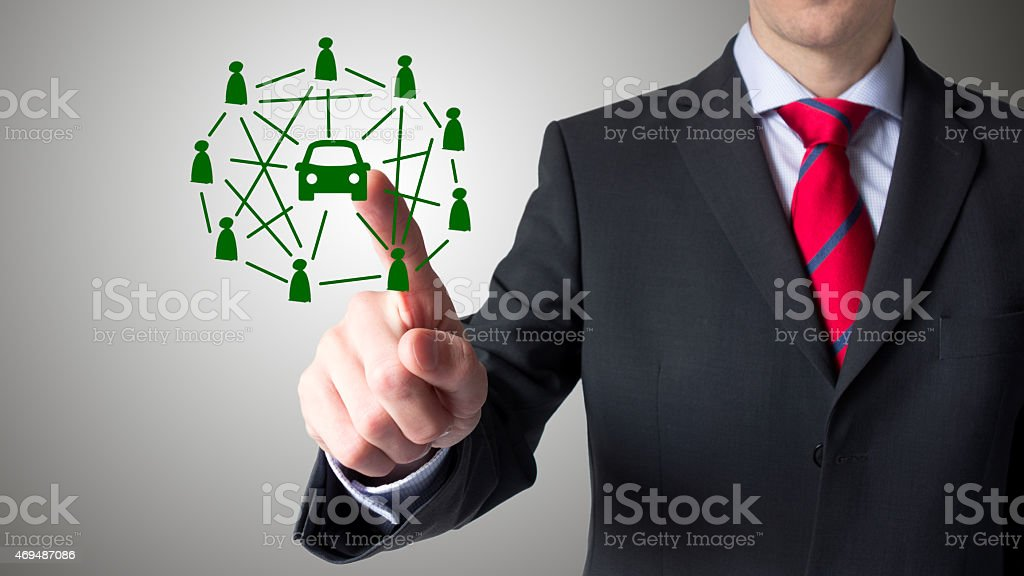 Man using a touch screen - car pooling stock photo