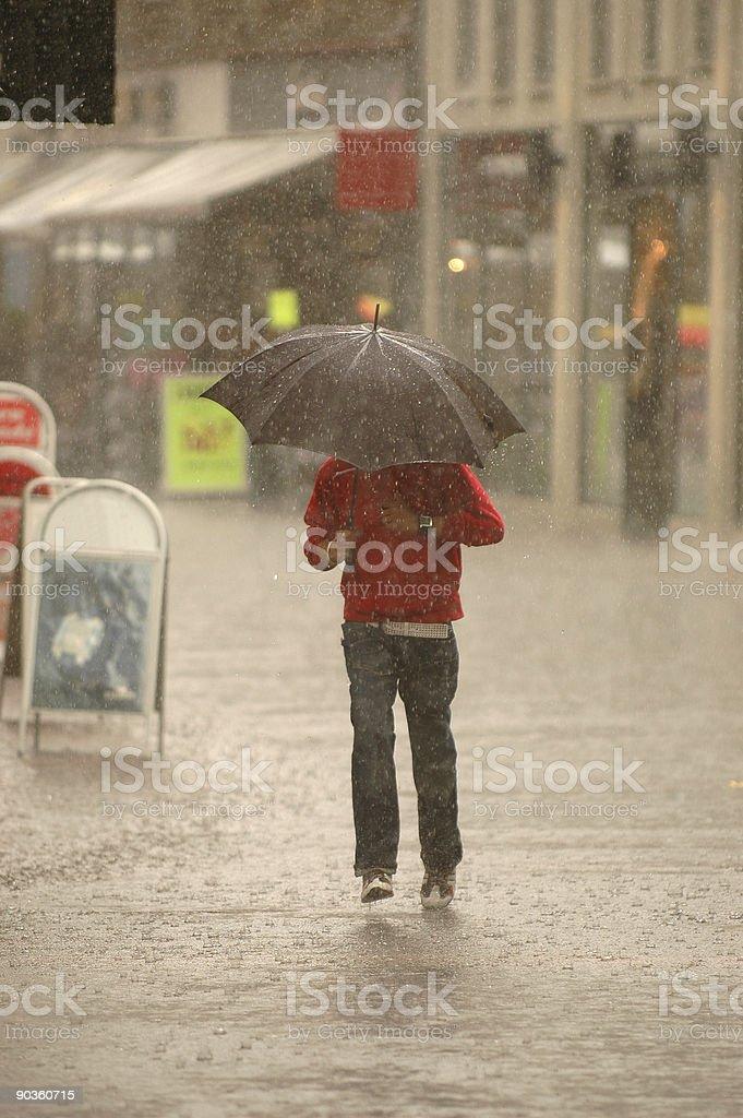 A man using a umbrella in the rain royalty-free stock photo