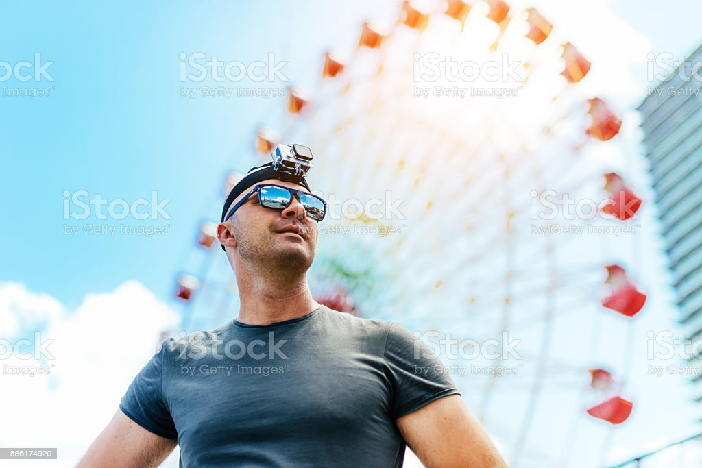 Man using action camera lookin for adventure stock photo