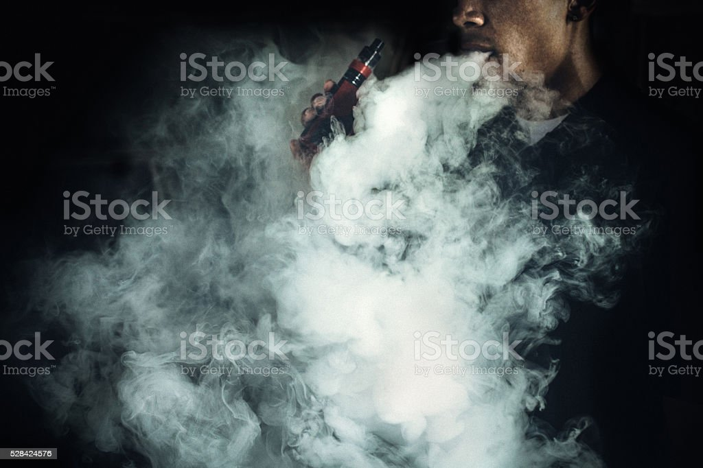 Man Using An Electric Cigarette stock photo