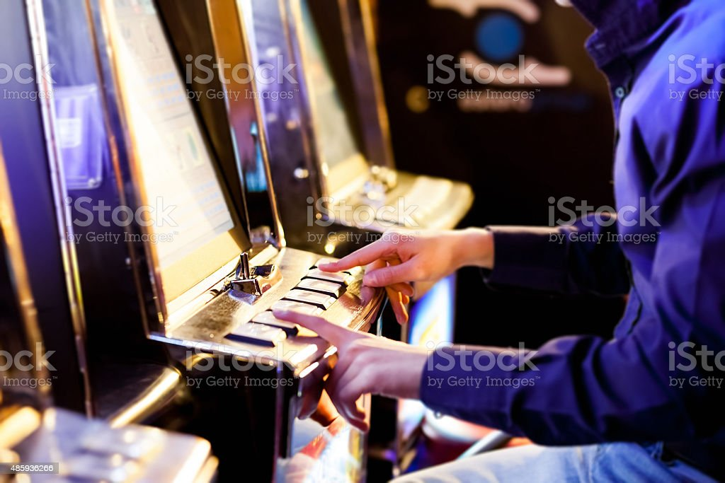 Man using an electronic slot machine stock photo