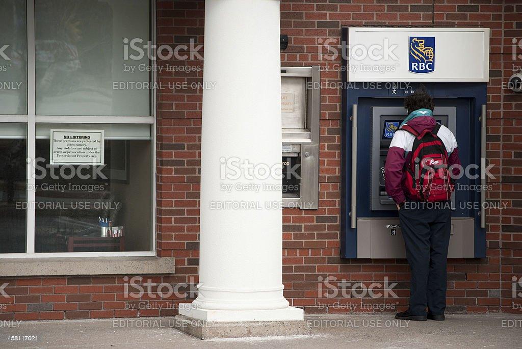 Man Using an Outdoor RBC ATM Machine stock photo