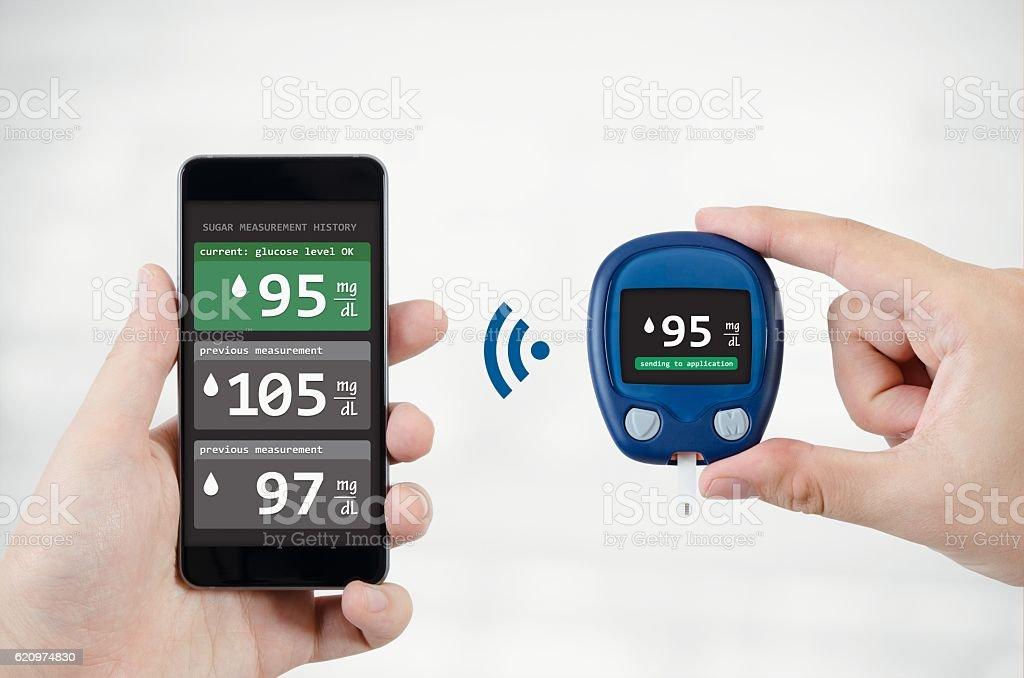 Man using application for diabetes stock photo
