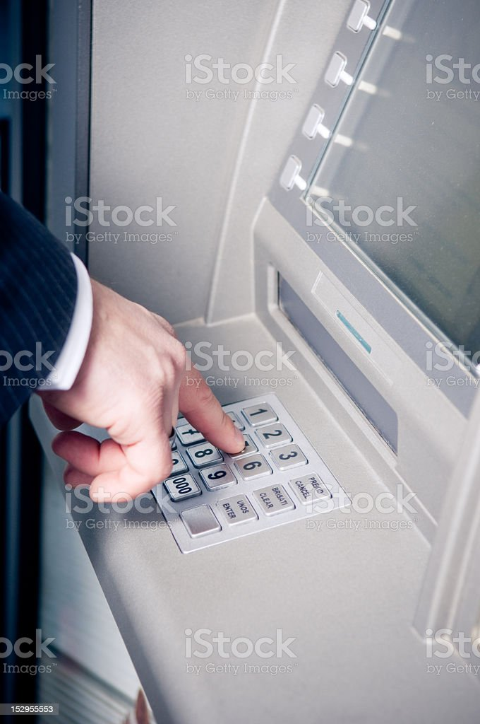 Man using ATM keypad while standing royalty-free stock photo