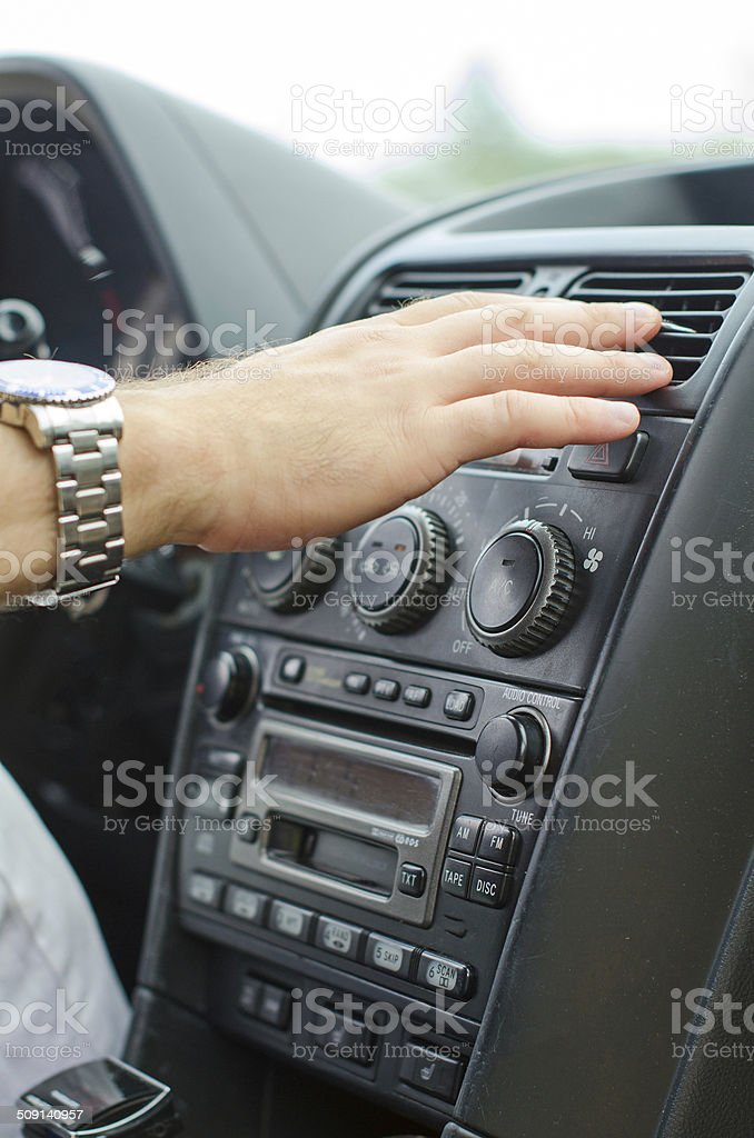 Man using automobile air conditioning system. stock photo