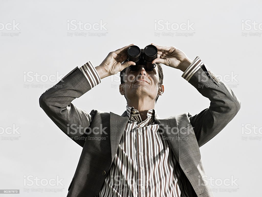 Man using binoculars royalty-free stock photo