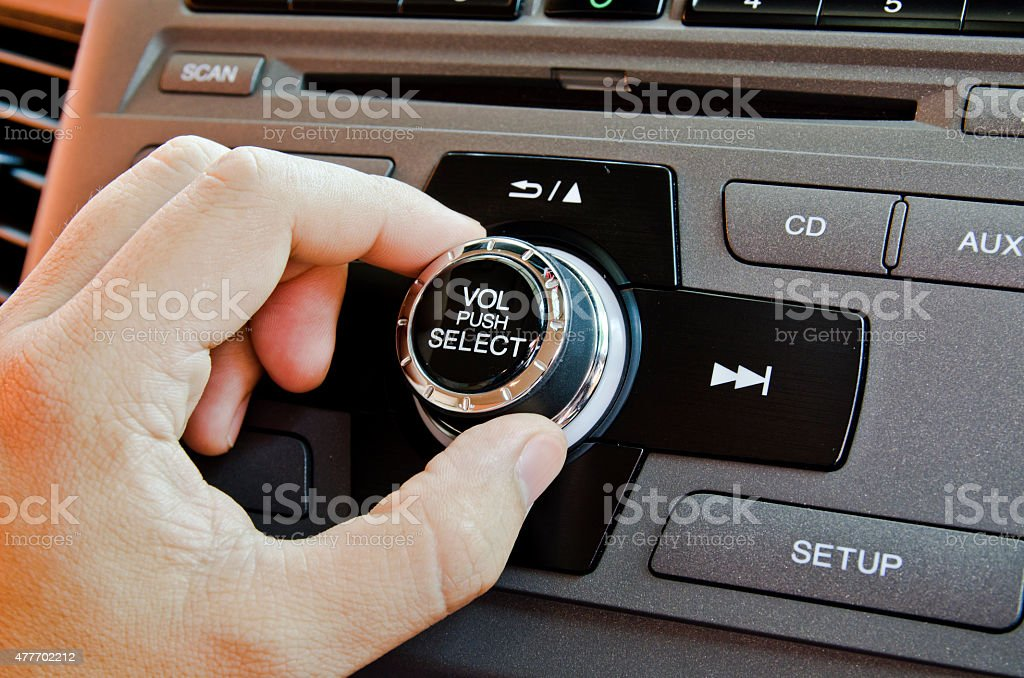 Man using car volume audio. stock photo