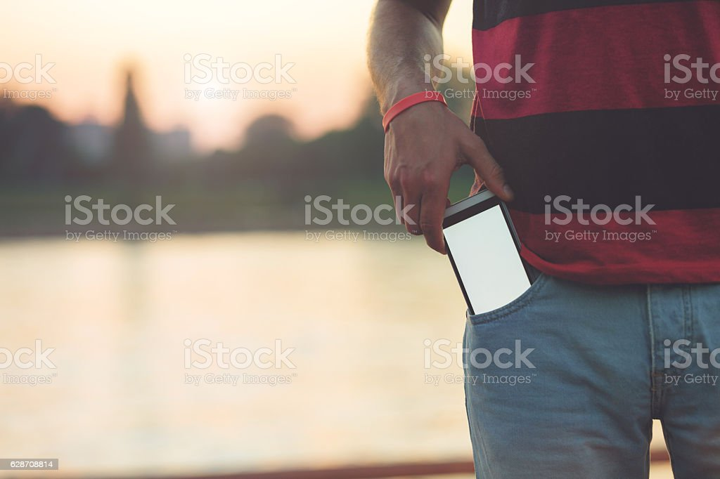 Man using cellphone outdoors. stock photo
