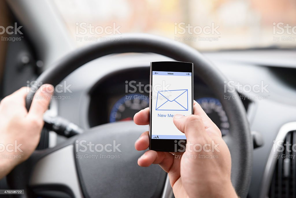 Man Using Cellphone While Driving stock photo