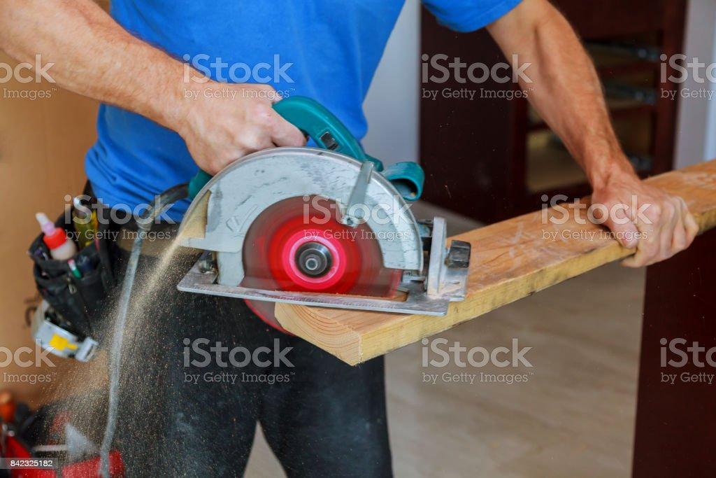 Man using circular saw stock photo
