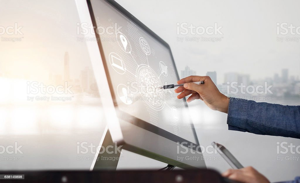 Man using computer and mobile payments online shopping stock photo